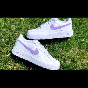Nike air force 1's with purple swoosh